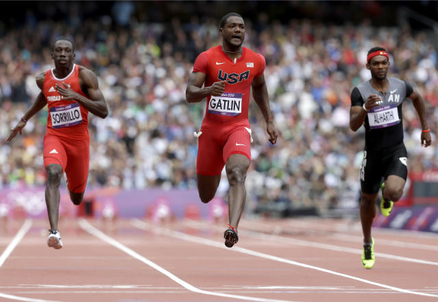 Trinidad's Rondel Sorrillo, United States' Justin Gatlin and Oman's Barakat Mubarak Al-Harthi compete in a men's 100-meter heat during the athletics in the Olympic Stadium at the 2012 Summer Olympics, London, Saturday, Aug. 4, 2012. (AP Photo/Anja Niedringhaus)
