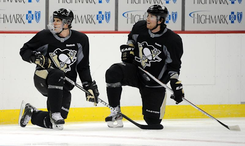 Pittsburgh Penguins hockey player Sidney Crosby, left, and teammate James Neal are shown on the ice at the Consol Energy Center in Pittsburgh Monday, April 15, 2013. (AP Photo/Tribune Review, Chaz Palla) PITTSBURGH OUT BEAVER COUNTY TIMES OUT MANDATORY CREDIT