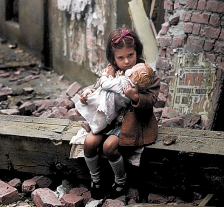 <p>A little girl was pictured cradling her doll amongst the rubble following another German bombing. (MediaDrumWorld) </p>
