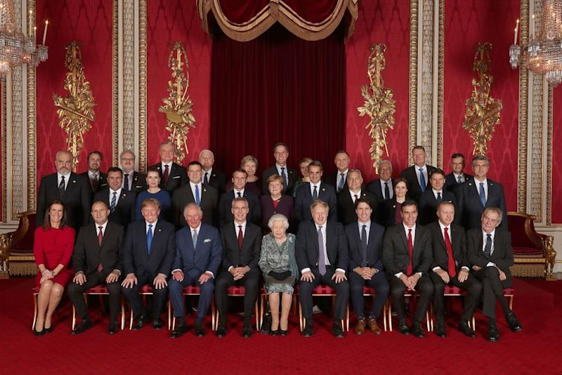 Leaders of NATO alliance countries, and its secretary general, join Queen Elizabeth and Prince Charles for a group picture to mark 70 years of the alliance | YUI MOK/POOL/AFP via Getty
