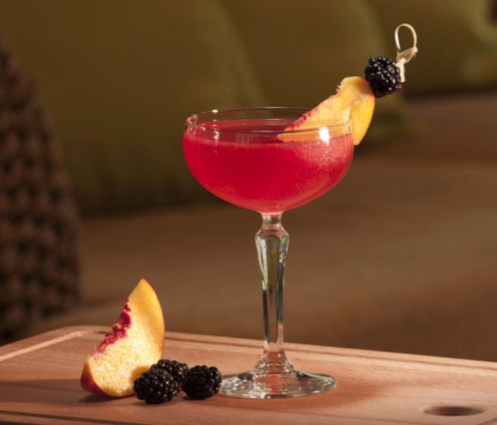 """<p><strong>Ingredients</strong><strong><br></strong></p><p>2 parts Sauza Signature Blue Silver tequila<br>.5 part peach juice<br>.5 part blackberry puree<br>.5 part lemon juice<br>1 part simple syrup<br>Peach slice<br>Blackberry</p><p><strong>Instructions</strong></p><p>Add ingredients to an ice-filled shaker. Shake and strain over ice into a coupe glass. Garnish by skewering a fresh blackberry and a slice of peach with a knot stick.</p><p><a class=""""link rapid-noclick-resp"""" href=""""https://go.redirectingat.com?id=74968X1596630&url=https%3A%2F%2Fdrizly.com%2Fsauza-signature-blue-silver-tequila%2Fp8247%3Fis_autocomplete%3Dtrue&sref=https%3A%2F%2Fwww.townandcountrymag.com%2Fleisure%2Fdrinks%2Fg2839%2Fhalloween-drinks%2F"""" rel=""""nofollow noopener"""" target=""""_blank"""" data-ylk=""""slk:Buy Now"""">Buy Now</a> Sauza Signature Blue Silver tequila, from $10.99<br></p>"""