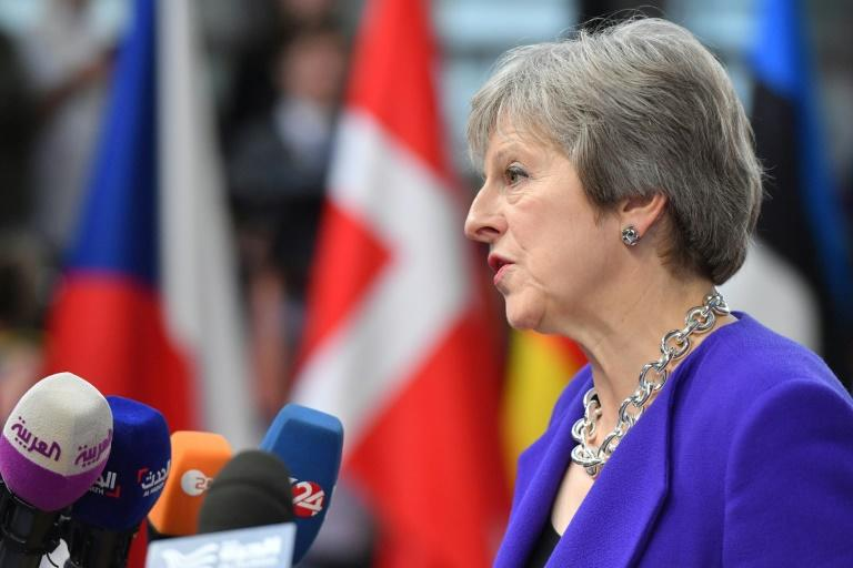 Prime Minister Theresa May says Britain will consider extending the transition period after Brexit for a few months