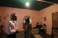 Wife of Giovanni Urbaneja talks with her husband's lawyer at her home in San Jose de Guanipa