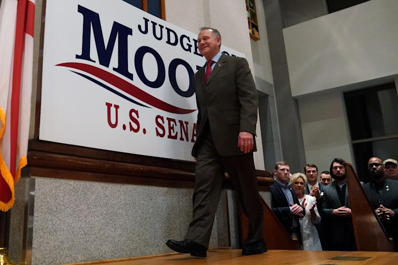 Republican U.S. Senate candidate Roy Moore walks on stage Tuesday at his election night party in Montgomery, Alabama. (Carlo Allegri / Reuters)