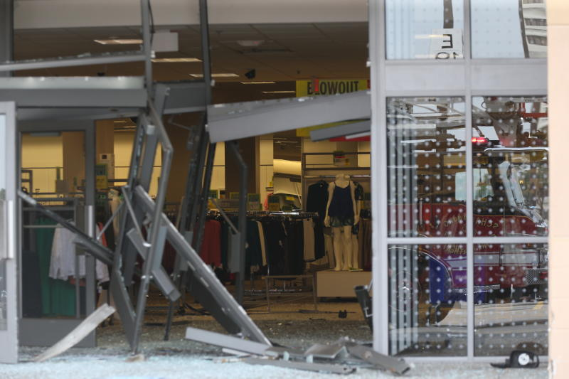 The damaged storefront of the Sears store at Woodfield Mall is seen after a man drove an SUV into the store in the Chicago suburb of Schaumburg, Ill., on Friday, Sept. 20, 2019. (John J. Kim/Chicago Tribune via AP)