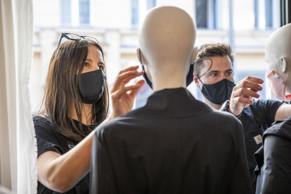 Boutique shopkeepers put protective masks on mannequins before they open their store for the first time since March in Berlin, Germany. (Maja Hitij/Getty Images)