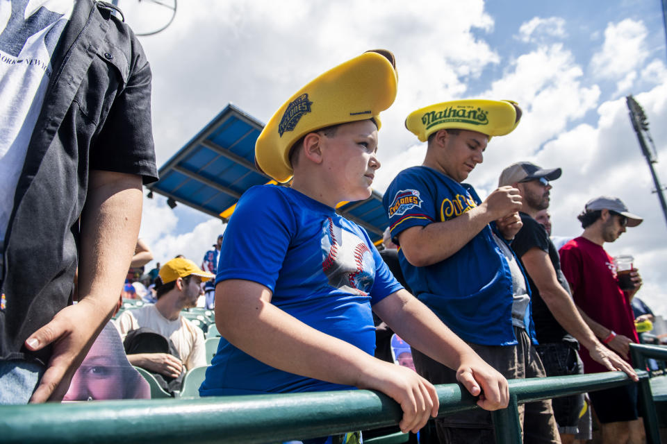 Mason Marriott, 9, watches from the stands at the Nathan's Famous Fourth of July International Hot Dog-Eating Contest in Coney Island's Maimonides Park on Sunday, July 4, 2021, in New York. (AP Photo/Brittainy Newman)