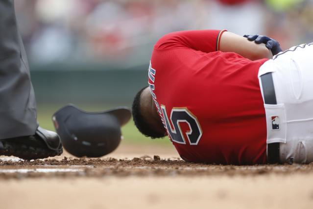 Minnesota Twins' Eduardo Escobar lies on the ground after he was hit by a pitch from Boston Red Sox' pitcher Rick Porcello in the first inning of a baseball game Thursday, June 21, 2018, in Minneapolis. (AP Photo/Jim Mone)