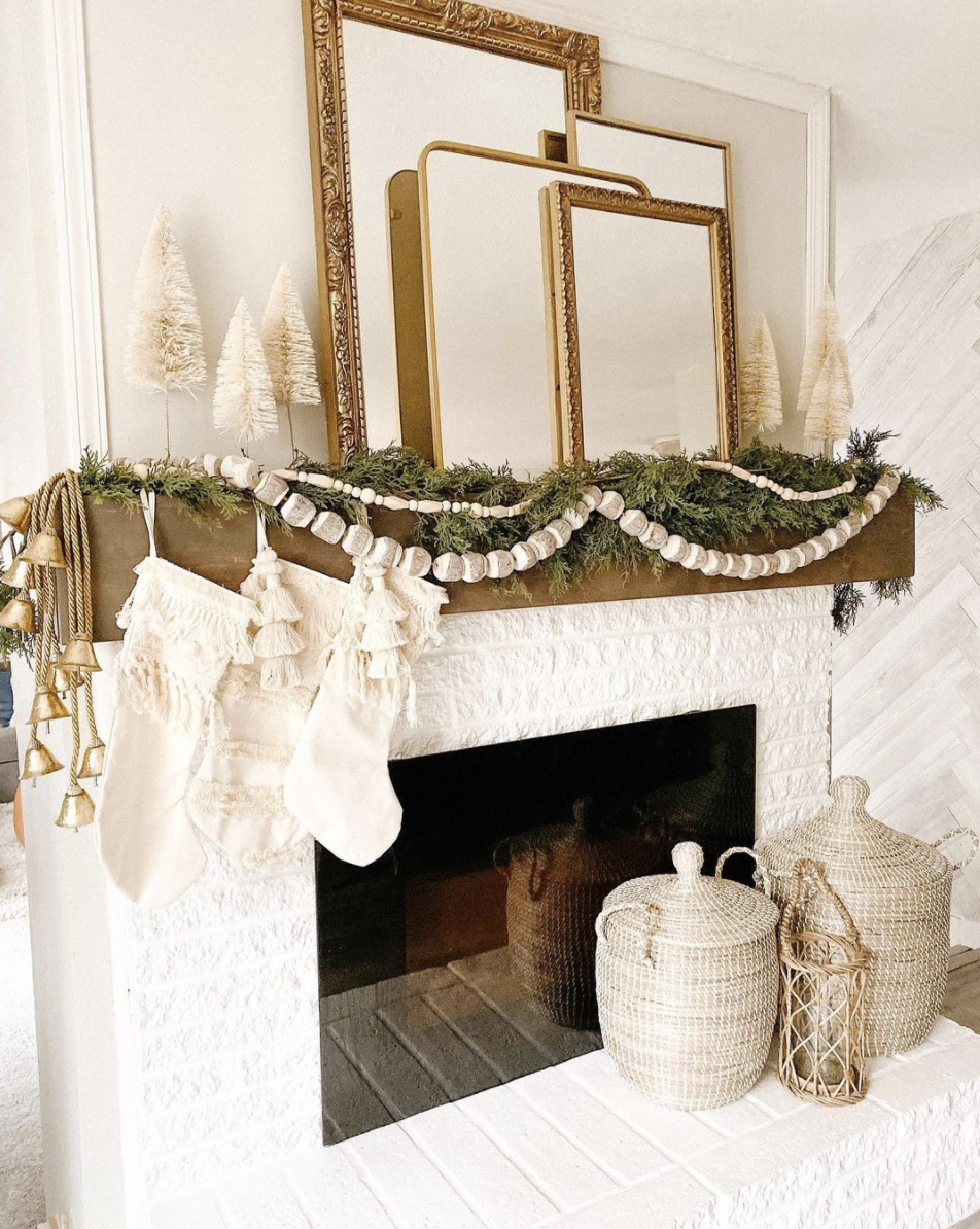 "<p>Make a farmhouse fireplace shine without the bright colors normally associated with the holiday. All you need: cream-colored accents with plenty of texture. Think tasseled stockings, beaded garland, and bottle brush trees. </p><p><em>See more at <a href=""https://www.instagram.com/p/B6QnUXtHPrE/"" rel=""nofollow noopener"" target=""_blank"" data-ylk=""slk:drab.to.dreamy"" class=""link rapid-noclick-resp"">drab.to.dreamy</a>.</em></p><p><a class=""link rapid-noclick-resp"" href=""https://www.amazon.com/Yalulu-Christmas-Tabletop-Ornaments-Decoration/dp/B07GSQMB5T?tag=syn-yahoo-20&ascsubtag=%5Bartid%7C10072.g.34484299%5Bsrc%7Cyahoo-us"" rel=""nofollow noopener"" target=""_blank"" data-ylk=""slk:SHOP DECORATIVE TREES"">SHOP DECORATIVE TREES</a></p>"