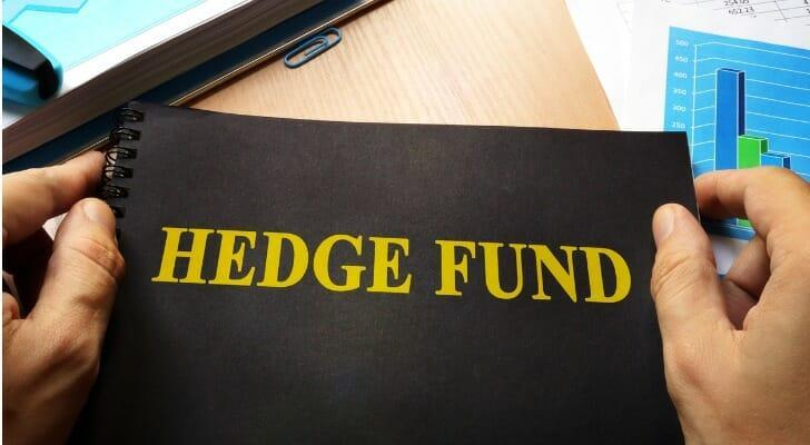 "A folder with ""HEDGE FUND"" printed on the front"