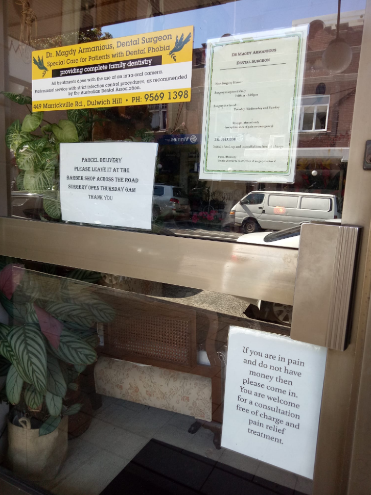 Sign in Dulwich Hill in Sydney on dentist surgery offering free services to people in pain with no money.