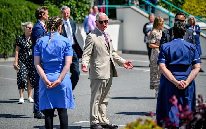 The Prince of Wales chats with care workers as the Duke and Duchess of Cornwall visit St Austell Healthcare, the Wheal Northey Centre - Ben Birchall/PA Wire