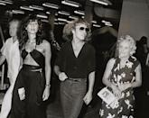 <p>Peter Frampton walks backstage at Madison Square Garden after a show in 1979. The musician is joined by his girlfriend, Barbara Gold, and his parents. </p>