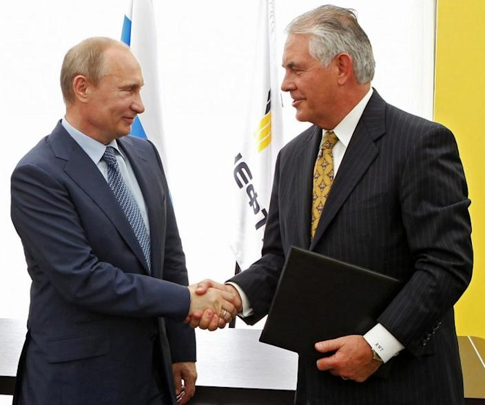 Russian President Vladimir Putin, left, and ExxonMobil CEO Rex Tillerson shake hands after signing an agreement between Russian oil company Rosneft and ExxonMobil at the Black Sea port of Tuapse in 2012. (Photo: AP/RIA-Novosti, Mikhail Klimentyev, Presidential Press Service)
