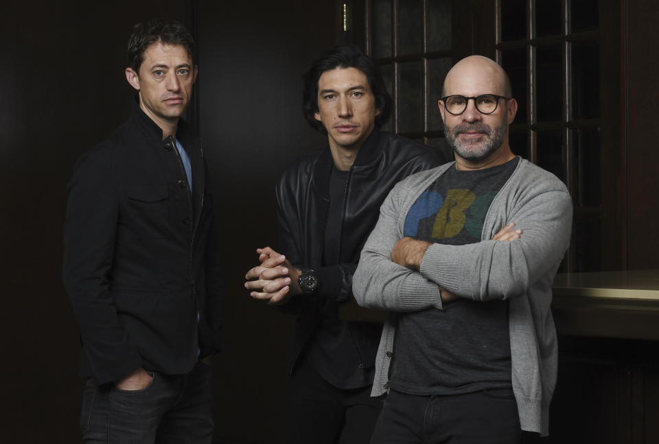 """This Sept. 7, 2019 photo shows Scott Z. Burns, right, writer/director of """"The Report,"""" posing with former FBI investigator Daniel J. Jones, left, and actor Adam Driver at the Omni King Edward Hotel during the Toronto International Film Festival in Toronto. (Photo by Chris Pizzello/Invision/AP)"""