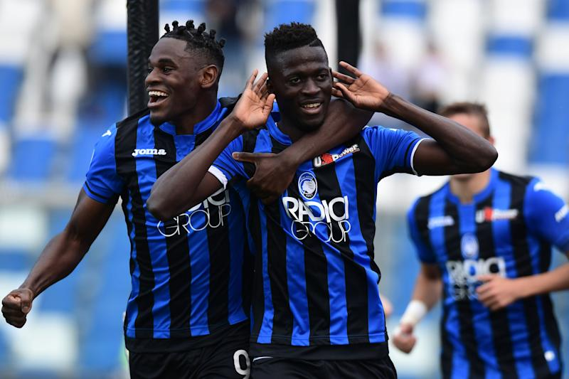 Atalanta's Gambian forward Musa Barrow (C) celebrate with Atalanta's Colombian forward Duvan Zapata after opening the scoring during the Italian Serie A football match Atalanta Bergama vs Genoa on May 11, 2019 at the Mapei Stadium - Citta del Tricolore in Reggio Emilia. (Photo by Miguel MEDINA / AFP) (Photo credit should read MIGUEL MEDINA/AFP/Getty Images)