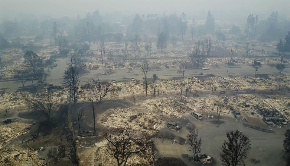 Wildfire destroyed a Santa Rosa, Calif. neighborhood; the smoke and air quality impacted Oakland Raiders practice on Wednesday. (AP)