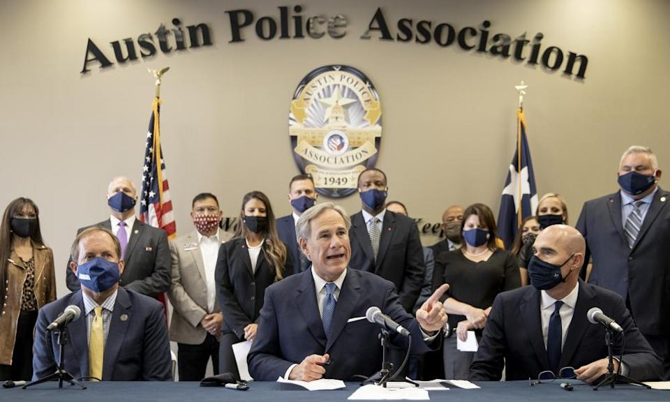 Greg Abbott speaks at a news conference before signing a 'Texas backs the blue pledge' at the Austin Police Association, 10 September 2020.