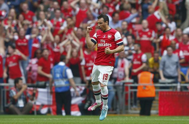 Arsenal's Santi Cazorla celebrates after scoring against Hull City during their FA Cup final soccer match at Wembley Stadium in London, May 17, 2014. REUTERS/Eddie Keogh (BRITAIN - Tags: SPORT SOCCER)