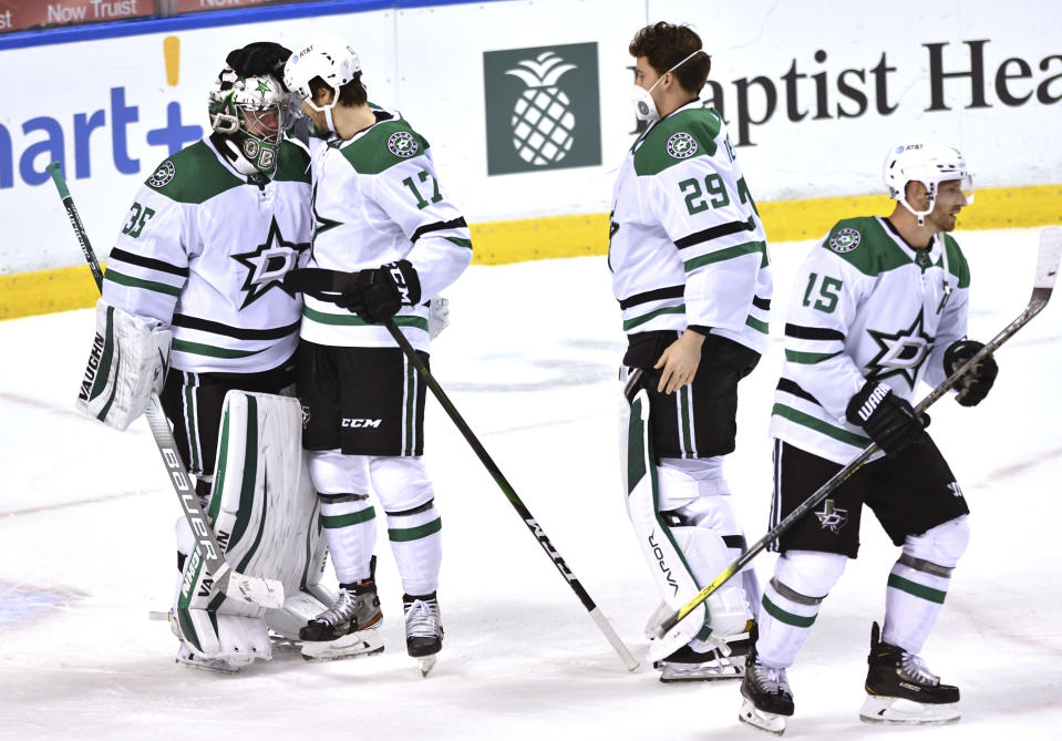 Dallas Stars goaltender Anton Khudobin (35) is congratulated by Nick Caamano (17) and teammates following a win over the Florida Panthers in an NHL hockey game Wednesday, Feb. 24, 2021, in Sunrise, Fla. (AP Photo/Jim Rassol)
