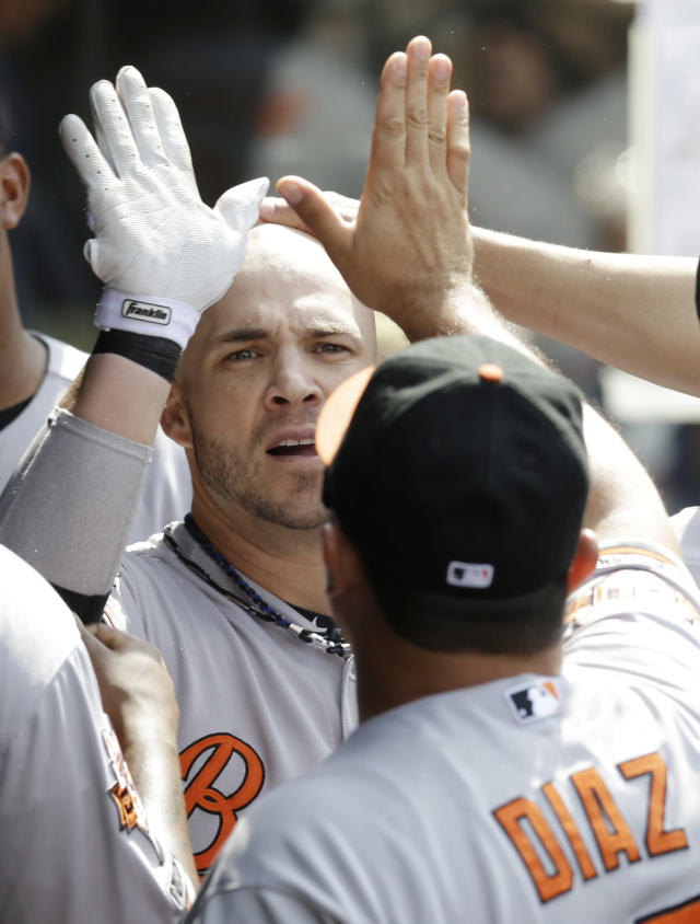 Baltimore Orioles' Steve Pearce is congratulated after hitting a solo home run off Cleveland Indians' Chen-Chang Lee in the seventh inning of a baseball game, Sunday, Aug. 17, 2014, in Cleveland. (AP Photo/Tony Dejak)