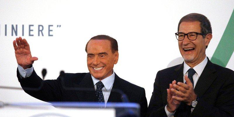 Forza Italia party leader Silvio Berlusconi (L) waves to supporters next to local candidate Nello Musumeci during a rally in Catania, Italy, November 2, 2017. REUTERS/Antonio Parrinello