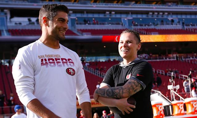 "<span class=""element-image__caption"">Katie Sowers chats with 49ers quarterback <a class=""link rapid-noclick-resp"" href=""/nfl/players/27590/"" data-ylk=""slk:Jimmy Garoppolo"">Jimmy Garoppolo</a> before the team's playoff victory over the Vikings this month.</span> <span class=""element-image__credit"">Photograph: Michael Zagaris/Getty Images</span>"
