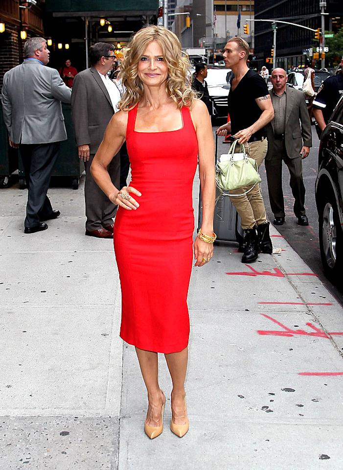 "Kyra Sedgwick lit up the gray streets of Manhattan on Wednesday when she  arrived for a taping of ""Late Show With David Letterman"" in this  figure-hugging, fire-engine-red frock. The fit 46-year-old -- who's been  busy promoting the final few episodes of her hit cable series, ""The  Closer"" -- accessorized with stacked gold bangles, nude-hued pumps, and  her signature smirk. (7/18/2012)<br> <br> <a target=""_blank"" href=""http://bit.ly/lifeontheMlist"">Follow 2 Hot 2 Handle creator, Matt Whitfield, on Twitter!</a>"