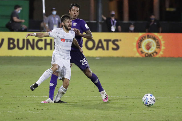 Los Angeles FC forward Diego Rossi (9) battles for the ball with Orlando City defender Antonio Carlos (25) during the second half of an MLS soccer match, Friday, July 31, 2020, in Orlando, Fla. (AP Photo/John Raoux)