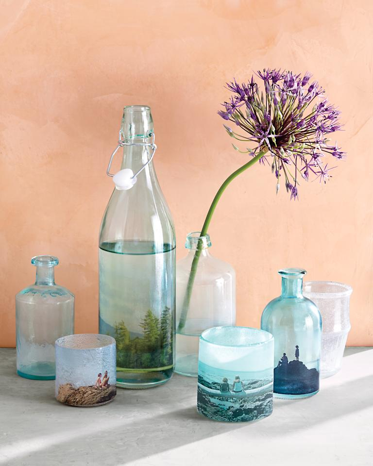 <p>Glass votive holders, vases, and bottles of all kinds are upcycled into beautiful table decorations when wrapped in decals -- printed from your own photo collection.</p>