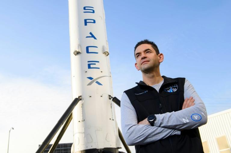 US tech billionaire Jared Isaacman in front of the first stage of SpaceX's Falcon 9 rocket, in February 2021 in Hawthorne, California (AFP/Patrick T. FALLON)