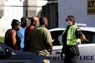 PHOTO: Memphis Police Department officers talk to nearby residents after a deadly shooting at a nearby post office, Oct. 12, 2021, in Memphis, Tenn. (Patrick Lantrip/Daily Memphian via AP)