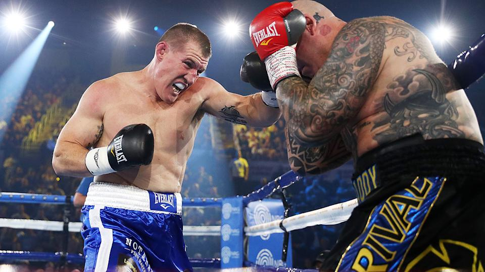 Paul Gallen punches Lucas Browne during their bout at WIN Entertainment Centre on April 21, 2021 in Wollongong, Australia. (Photo by Mark Metcalfe/Getty Images)
