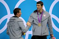 <b>Medal No. 20</b><br>Gold medalist Michael Phelps (R) of the United States shakes hands with Silver medalist Ryan Lochte of the United States on the podium during the medal ceremony for the Men's 200m Individual Medley final on Day 6 of the London 2012 Olympic Games at the Aquatics Centre on August 2, 2012 in London, England. (Photo by Ezra Shaw/Getty Images)