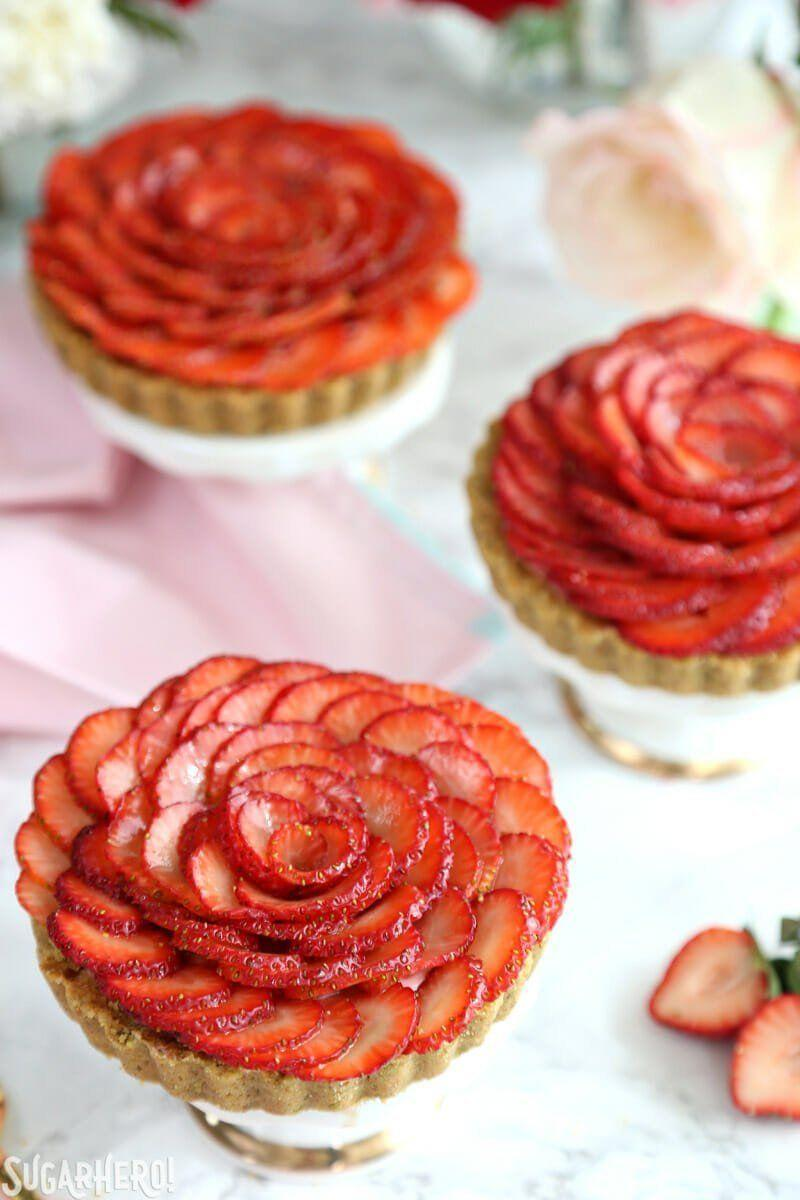 "<p>Rosewater, strawberries, and white chocolate are featured in the berry mouse that fills these graham cracker tarts, topped with a strawberry rose.</p><p><strong>Get the recipe at <a href=""https://www.sugarhero.com/strawberry-rose-tarts/"" rel=""nofollow noopener"" target=""_blank"" data-ylk=""slk:SugarHero"" class=""link rapid-noclick-resp"">SugarHero</a>.</strong></p><p><strong><a class=""link rapid-noclick-resp"" href=""https://www.amazon.com/Webake-Inch-Quiche-Removable-Bottom/dp/B01M9A33NL/?tag=syn-yahoo-20&ascsubtag=%5Bartid%7C10050.g.1138%5Bsrc%7Cyahoo-us"" rel=""nofollow noopener"" target=""_blank"" data-ylk=""slk:SHOP TART TINS"">SHOP TART TINS</a><br></strong></p>"