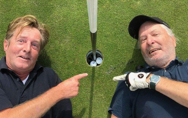 Golfers Peter Orton and Wayne Eagling celebrate their hole in one