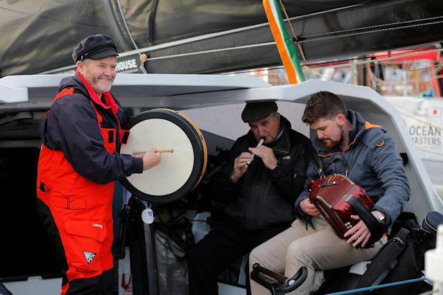 Skipper Enda O'Coineen of Ireland (L) play music on his monohull just before to leave Les Sables d'Olonne, on France's Atlantic coast, to start in the Vendee Globe sailing race, western France, November 6, 2016. REUTERS/Stephane Mahe