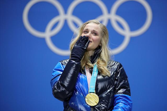 <p>Gold medalist Stina Nilsson of Sweden reacts during the medal ceremony for the Cross-Country Ladies' Sprint Classic. (Getty) </p>