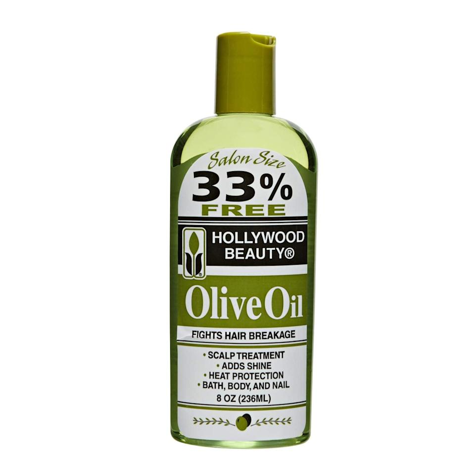 """<p><a href=""""https://www.popsugar.com/buy/Hollywood-Beauty-Olive-Oil-586438?p_name=Hollywood%20Beauty%20Olive%20Oil&retailer=amazon.com&pid=586438&price=12&evar1=bella%3Aus&evar9=47589908&evar98=https%3A%2F%2Fwww.popsugar.com%2Fphoto-gallery%2F47589908%2Fimage%2F47590161%2FHollywood-Beauty-Olive-Oil&list1=hair%2Chair%20products%2Cbeauty%20shopping&prop13=api&pdata=1"""" class=""""link rapid-noclick-resp"""" rel=""""nofollow noopener"""" target=""""_blank"""" data-ylk=""""slk:Hollywood Beauty Olive Oil"""">Hollywood Beauty Olive Oil</a> ($12) not only smooths the hair and adds softness, but you can also massage it into your scalp for a little extra moisture if dryness or flakes are major concerns for you.</p>"""