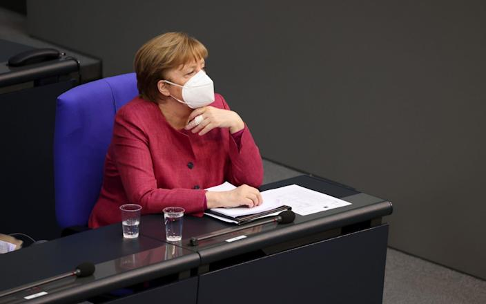 Merkel, who is stepping down this year after 16 years at the reins, said she was 'delighted' to have got the AstraZeneca jab - Bloomberg