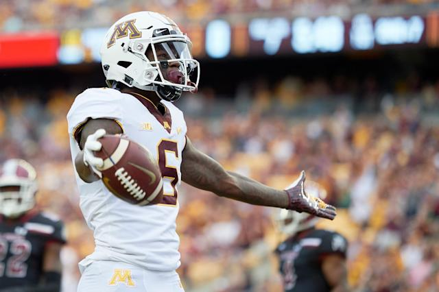 "Minnesota WR <a class=""link rapid-noclick-resp"" href=""/nba/players/5376/"" data-ylk=""slk:Tyler Johnson"">Tyler Johnson</a> celebrates scoring a touchdown against New Mexico State (Getty Images)."