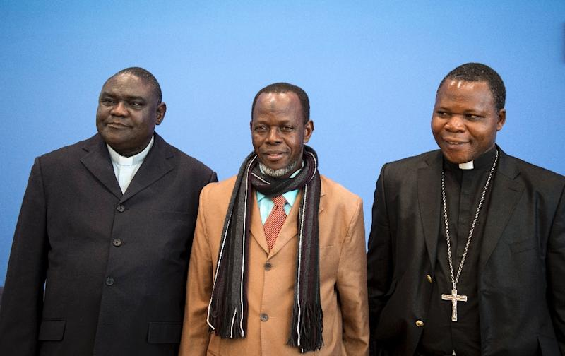 (L-R) Head of Central Africa's Evangelical Alliance, Pastor Nicolas Guerekoyame Bangou, head of the country's Islamic Council, Imam Kobine Layama, and Catholic Archbishop of Bangui, Dieudonne Nzapalainga, on March 31, 2014 in Berlin