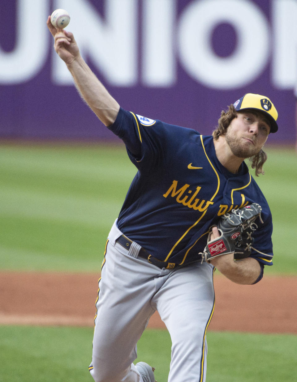 Milwaukee Brewers starting pitcher Corbin Burnes delivers against the Cleveland Indians during the first inning of a baseball game in Cleveland, Saturday, Sept. 11, 2021. (AP Photo/Phil Long)
