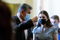 Sen. Joe Manchin, D-W.Va., speaks to an aide as he walks out of a Democratic policy luncheon as work continues on the Democrats' Build Back Better Act, massive legislation that is a cornerstone of President Joe Biden's domestic agenda, at the Capitol, in Washington, Tuesday, Sept. 14, 2021. (AP Photo/Andrew Harnik)