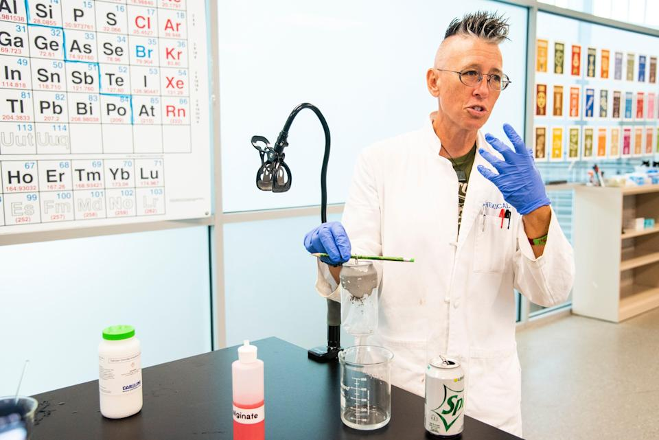 """Kim Hilton, a TikTok influencer who goes by """"Chemical Kim"""" on social media, shows off a recent experiment she did for a video at Florida SouthWestern State College-Collier Campus in Naples, Fla., on Aug. 31, 2021."""