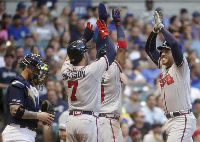 Atlanta Braves' Freddie Freeman is congratulated by Ronald Acuna Jr. (13) and Freddie Freeman (5) after hitting a three-run home run during the fourth inning of a baseball game against the Milwaukee Brewers Monday, July 15, 2019, in Milwaukee. (AP Photo/Morry Gash)