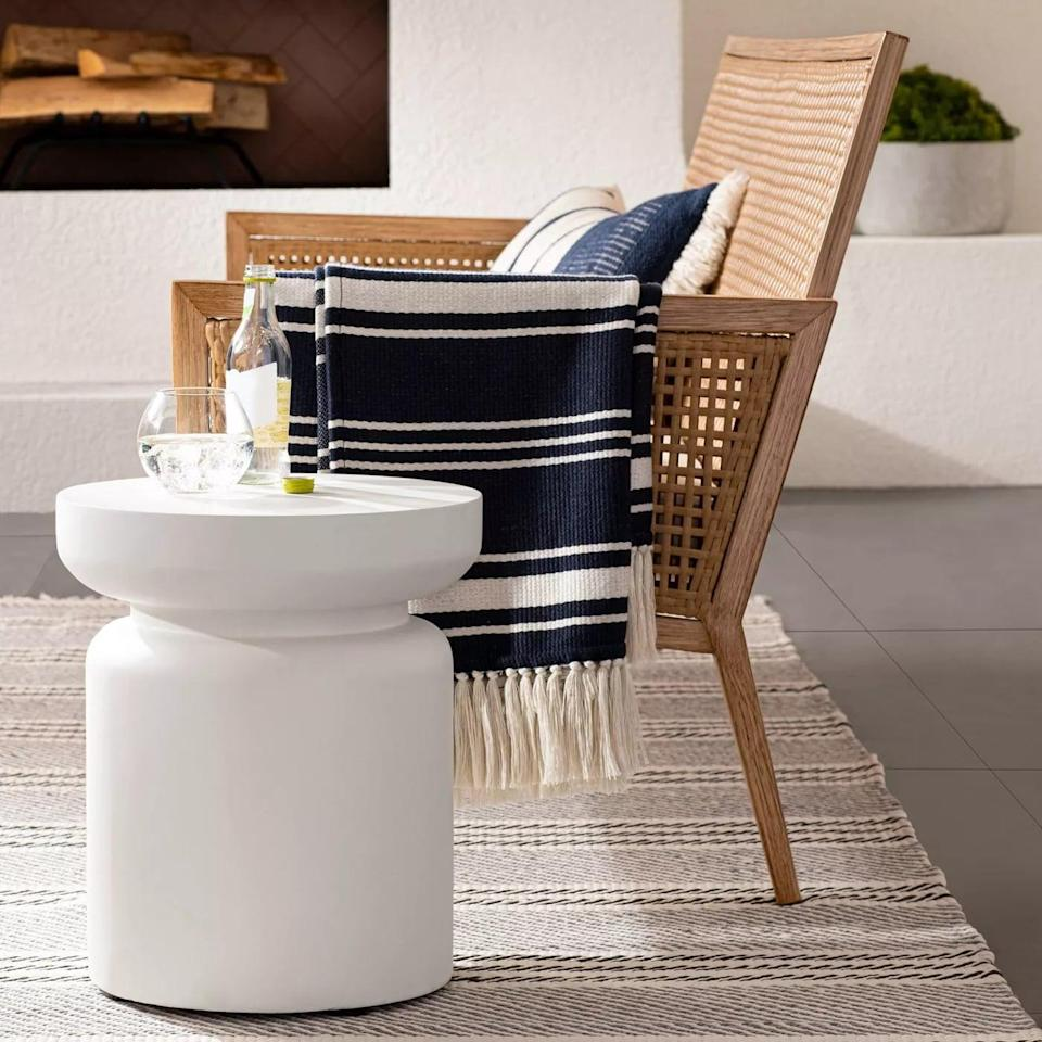 <p>The <span>Turned Drum Patio Accent Table</span> ($89) is so sleek looking.</p>
