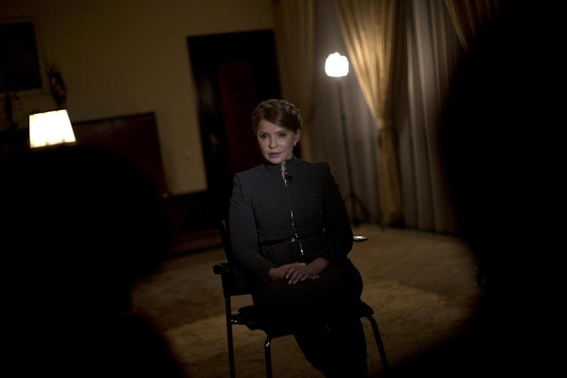 Former Ukrainian Prime Minister Yulia Tymoshenko poses for a photo during an interview with the Associated Press in Kiev, Ukraine, Wednesday, March 5, 2014. Tymoshenko says the West must force Russia to withdraw troops from the Crimean peninsula and that Ukraine should not agree to any compromises with Russia. (AP Photo / Emilio Morenatti)