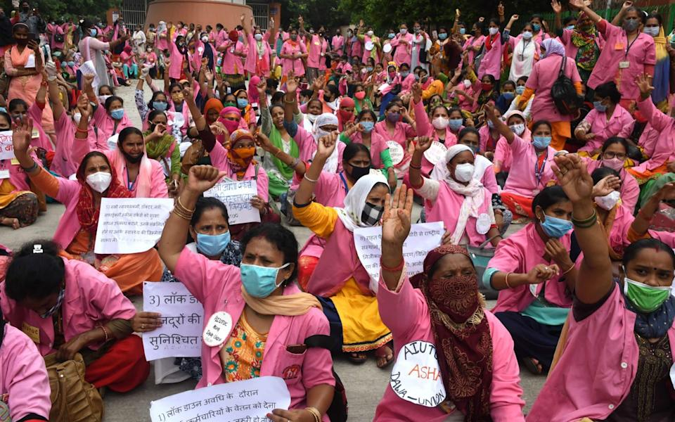 Accredited Social Health Activist, who are also involved in collecting coronavirus disease related data, launched a two-day strike for various demands including better wages, protection from the infectious disease and medical insurance in New Delhi, India - STRINGER/EPA-EFE/Shutterstock