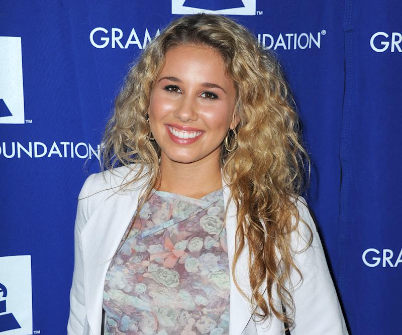 "FILE - This July 17, 2012 file photo shows Haley Reinhart attending the ""GRAMMY Camp Guest Professional Day"" in Los Angeles. Lollapalooza, starting Friday, Aug. 3, 2012, on Chicago's lakefront will have well-known headliners, like The Red Hot Chili Peppers and The Black Keys, but it also will have a special focus on dance music. Two electronic heavyweights, Avicii and Justice, will play main stage show this year. Festival founder and Jane's Addiction lead singer Perry Farrell said he looks at his more than 130-artist lineup as a guide to what's happening in music. (Photo by Katy Winn/Invision/AP, file)"